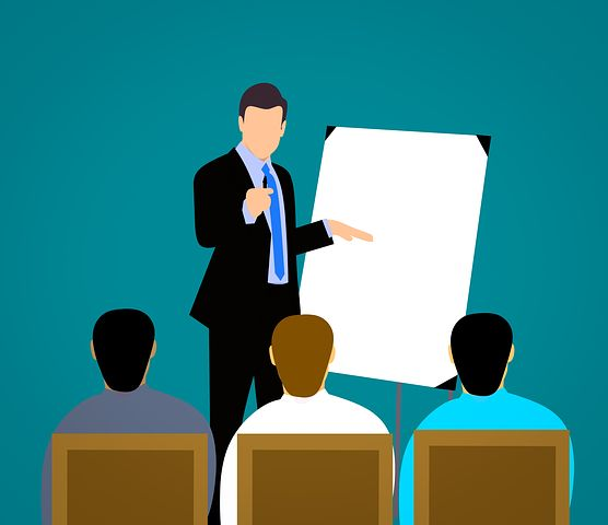 boss pointing to board in meeting